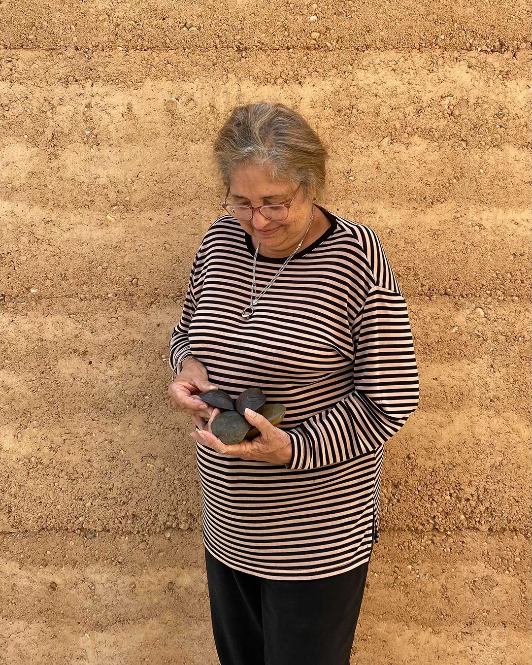 Aunty Joy Murphy Wandin holds a cast mussel.